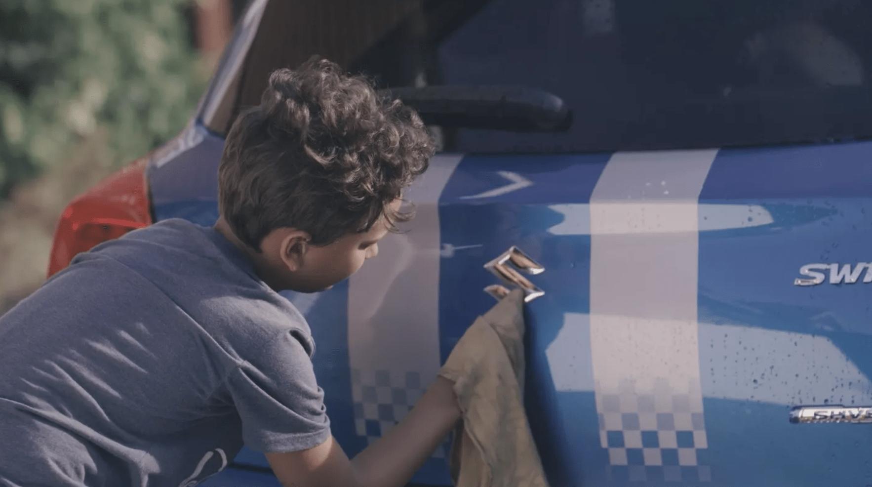 boy polishing car