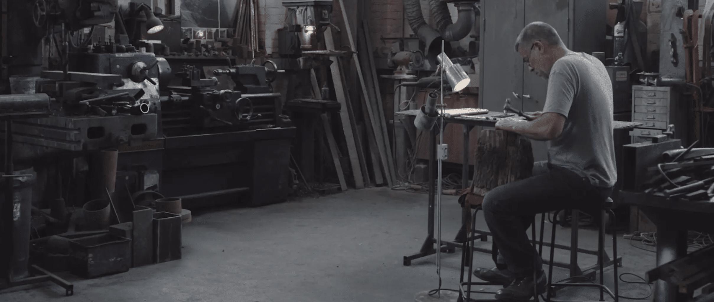 man in workshop hammering